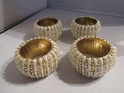 Set of Four Ivory Pearl, Silver, and Gold Napkin Rings – E